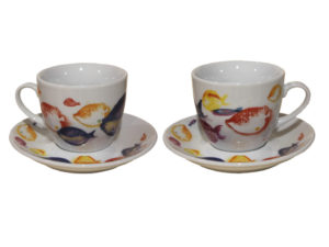 cup and saucer with colorful fish , soggetti marini ,pesci rossi